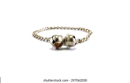 Old dog chain with bells isolated on white background
