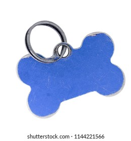 Old dog name tag in shape of bone, blue, isolated on white