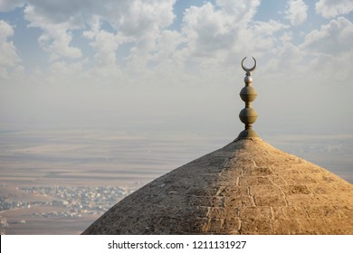 Old dome mosque in the city of Mardin Turkey, against the backdrop of the valley of Mesopotamia