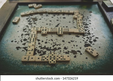 Old domino stones on the game table