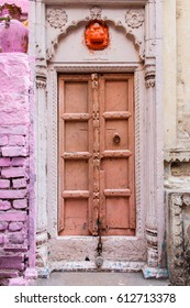 An old door in a brick wall. Pink brick. Pastel shades.