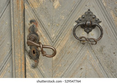 old door old castle with wrought-iron handle and knocker