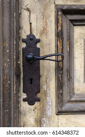 Old door with forged handle.