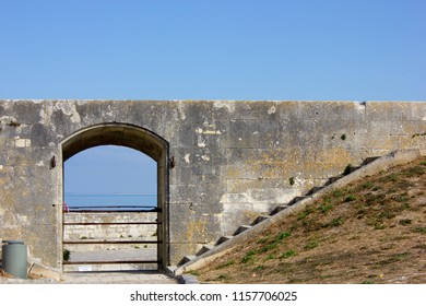 Old door in Fortress of Vauban by the sea, France