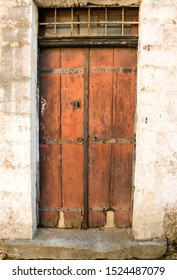 Old door with iron fittings in abandoned house