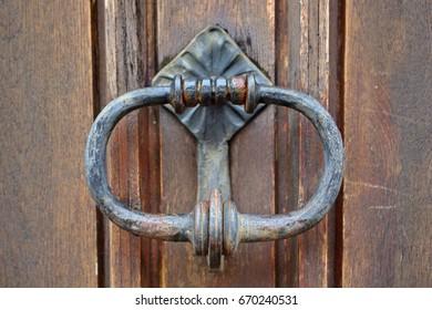 Old door knob on wooden door