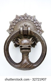 Old door knocker on white background.
