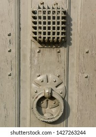 Old door knocker with see-through hatch