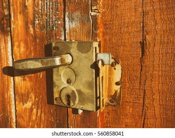 old  door lock vintage wood background