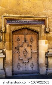 Old Door of Schola Naturalis Philosophie( Natural Philosophy school) in University. Oxford, UK