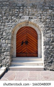 old door with the stone wall in the old town of Budva in Montenegro