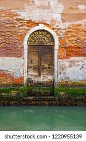 Old door in the Venice canal