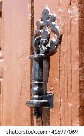 Old doorknob or knocker that serve as decoration on the doors of houses.