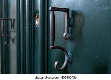 Old doorknobs, doorknockers and handles on ancient doors