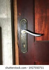 old doorknobs in natural wood