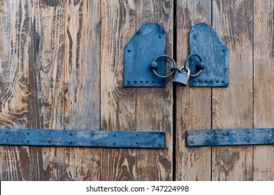 old doors with a black lock