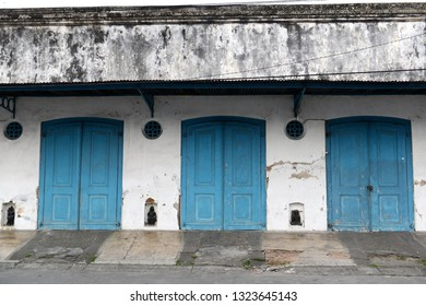 Old doors with blue color.