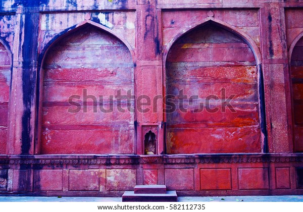 Old doors near Taj Mahal (UNESCO World Heritage Site). Red arcs. Pattern, background. Agra, India.
