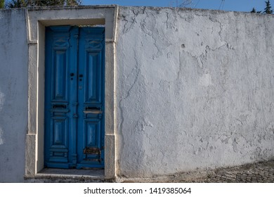 Old doorway in a wall in Tavira Portugal.