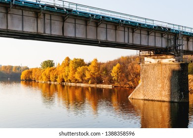 Old Dorogomilovsky railway bridge and Third Ring Road. Autumn cityscape with transport infrastructure and Moscow-river. View from Taras Shevchenko embankment, Moscow, Russia.