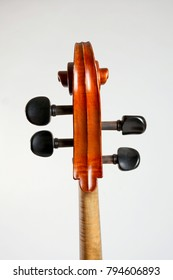 Old double bass head isolated on white background