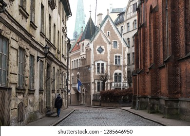 Old down in Riga, Latvia, with pedestrian walking down the street