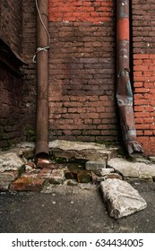 Old downspout and brick wall. Grunge background