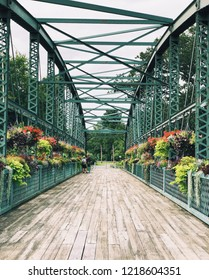 Old Drake Hill Flower Bridge is a bridge in Simsbury, Connecticut,United States. Originally carrying Drake Hill Road over the Farmington River. It is one of three surviving Parker truss bridges.