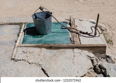 Old draw well with bucket in Bulunkul in Tajikistan