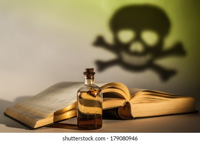 Old drug in a bottle, a poisson sign and a book