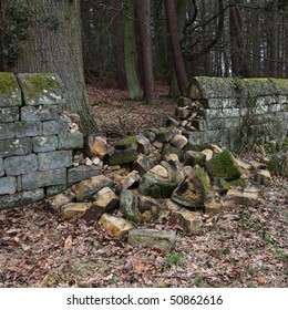 An old dry stone wall that has collapsed and requires repair