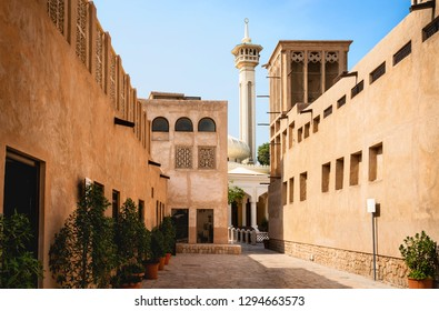 Old Dubai view with mosque, buildings and traditional Arabian street. Historical Al Fahidi neighbourhood, Al Bastakiya. Heritage district in United Arab Emirates (UAE).