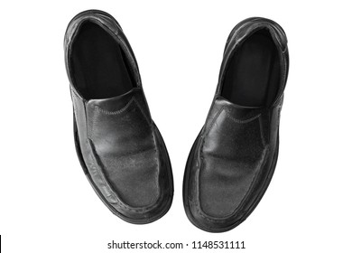 Old dusty black leather Slip-on Shoes for businessman, top view isolated on white background