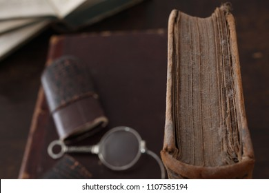 old dusty book with reading glasses