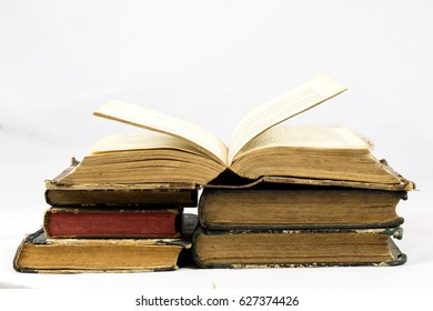 Old dusty book and sheet of paper on white isolated background