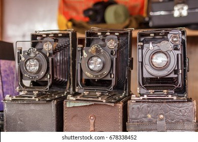 Old dusty camera. Technology of the last century. Premium photography equipment. Vintage appliances. Russia, Moscow flea market 08.07.2017