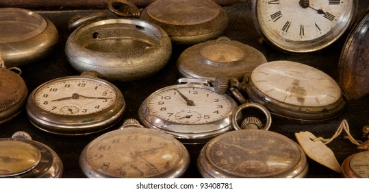 Old Dusty Watches - vintage pocket watches gather dust in display case - texture added for vintage feel