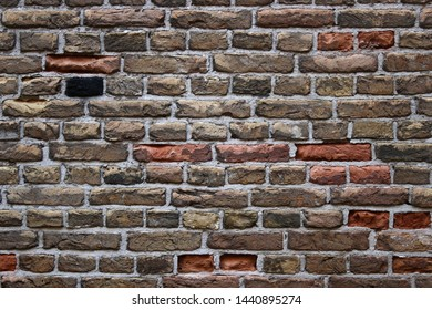Old dutch brickwork masonry wall background texuture with dark colors