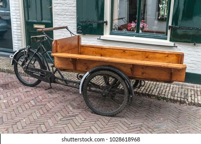 old Dutch cargo bike parked in front of a house