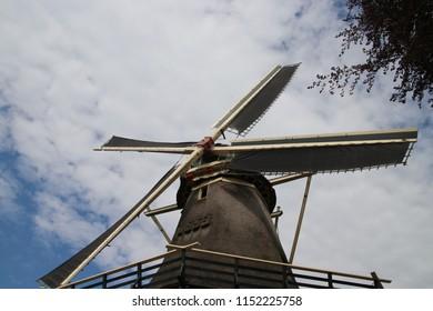 Old dutch windmill in village named Oldebroek with name De Hoop, still working as peel and as grind mill