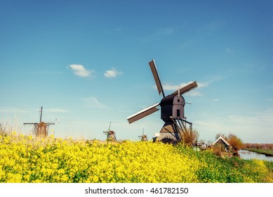 Old Dutch windmills spring from the canal in Rotterdam. Holland.