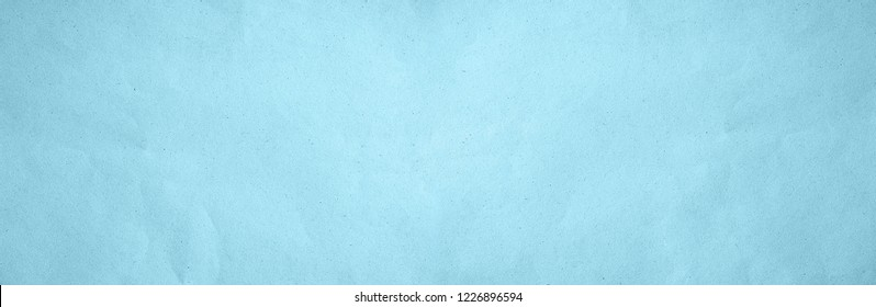 Old eco blue paper kraft wide screen background texture in soft white light teal color concept for page banner wallpaper design, turquoise matte pattern for decorative wall. Cyan pastel theme pattern.