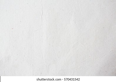 Old eco paper kraft texture in white light on table concept for creative flat card background design. Pattern of simple raw surface use decorative for image cardboard recycle and new earth tone theme.