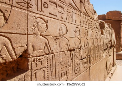 Old Egypt hieroglyphs carved on the stone wall in The Karnak Temple Complex, Luxor, Egypt (ancient Thebes).