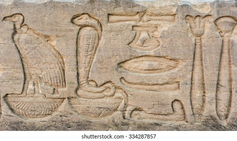 old egypt hieroglyphs carved on the stone. Detail from temple wall in Egypt.