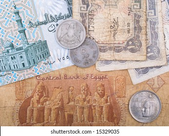 Old Egyptian currency banknotes and coins