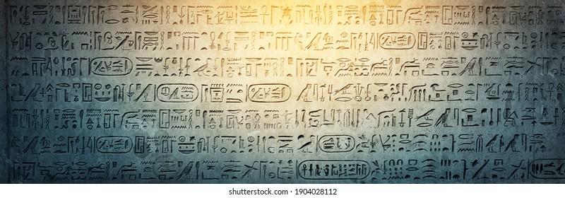 Old Egyptian hieroglyphs on an ancient background. Wide historical background. Ancient Egyptian hieroglyphs as a symbol of the history of the Earth.  - Shutterstock ID 1904028112