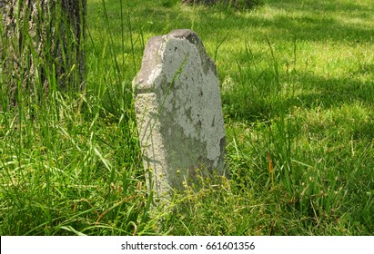 Old eighteenth-century tombstone in rural family cemetery