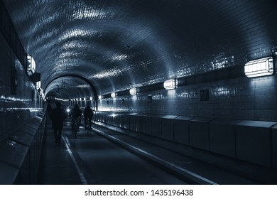 Old Elbe Tunnel or St. Pauli Elbe Tunnel which opened in 1911, is a pedestrian and vehicle tunnel in Hamburg, Germany. Blue toned photo