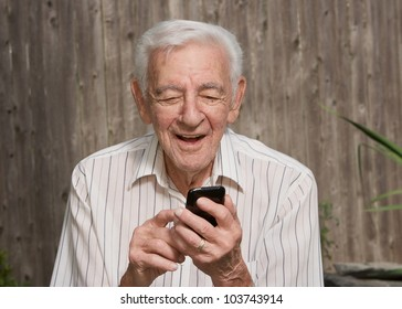 Old elder senior man on mobile smart phone